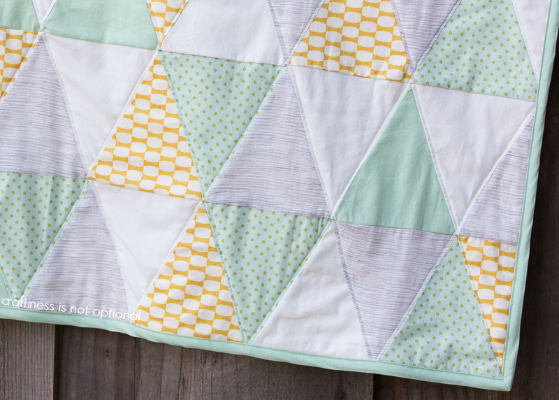 close up triangle quilt by craftiness is not optional