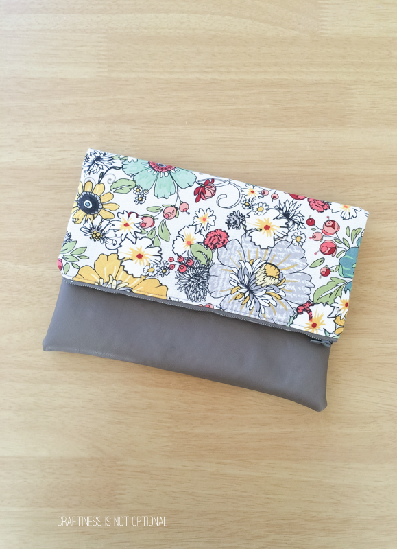 floral and leather foldover clutch